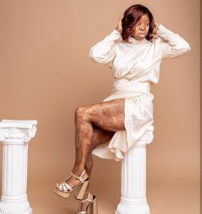 Kechi Okwuchi Shows Off Her Legs In A Dress With Thigh-High Slit.